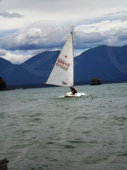 Man sailing laser sailboat photo