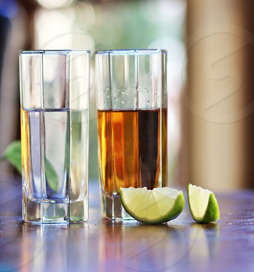 Tequila anejo gold silver and limes  photo