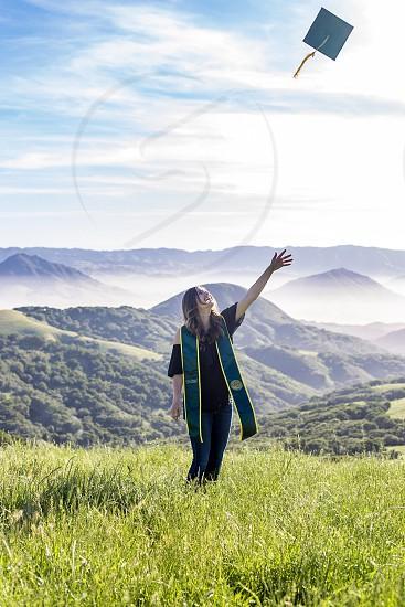 Graduation millennial green hills meadows photo