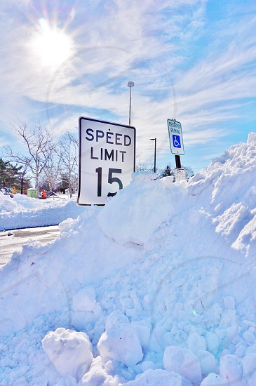 Road signs buried in snow after a winter storm in Princeton NJ photo
