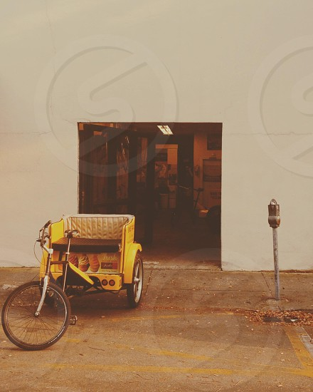 yellow   trike  on a street  photo