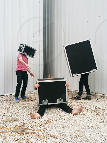 people using a black metal framed chest as props photo