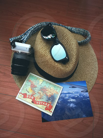 travel inspirations with map sunhat sunglasses camera and photo from the plane photo