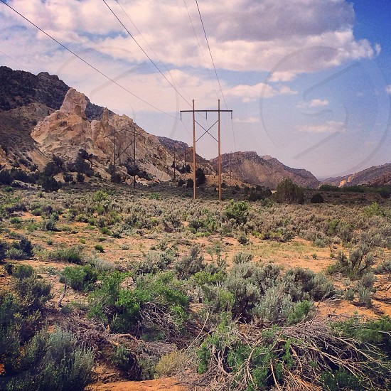 electric tower in the middle of a dessert photo
