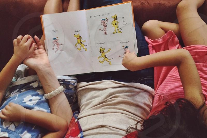 girls watching book page photo