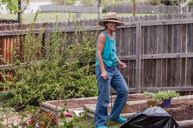 Smiling woman enjoying gardening.  photo