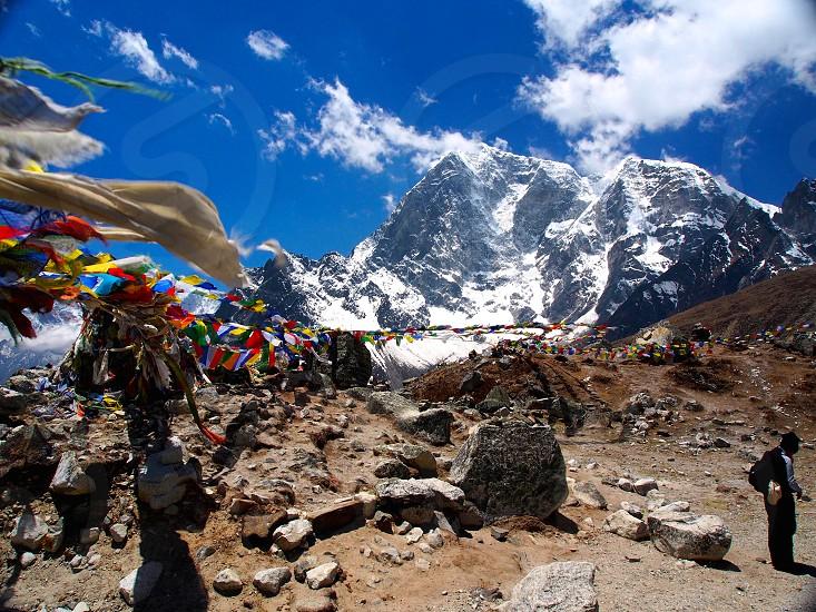 Nepal Himalayas mountains explore nature adventure trekking hiking prayer flags photo