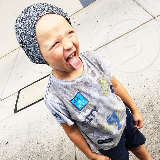Little boy making funny faces photo