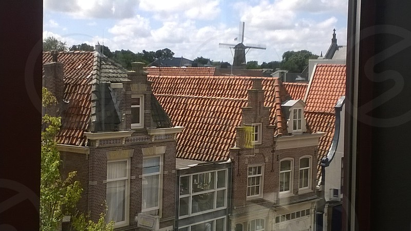 Holland Netherlands Alkmaar Birds Eye View  Windmill Rooftops Houses Clouds Sky Europe  photo
