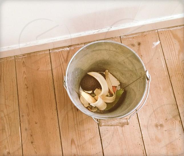 yellow banana peels in gray steel pail photo