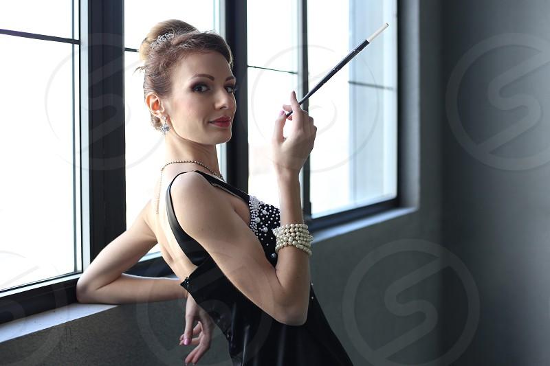 woman  beautiful lady black dress cigarette smoking photo