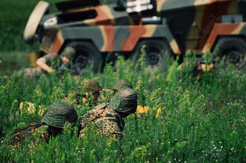 Military army soldiers camouflage hiding war combat fighting camo armored vehicles crawling crawl army soldier truck field unrecognizable people photo