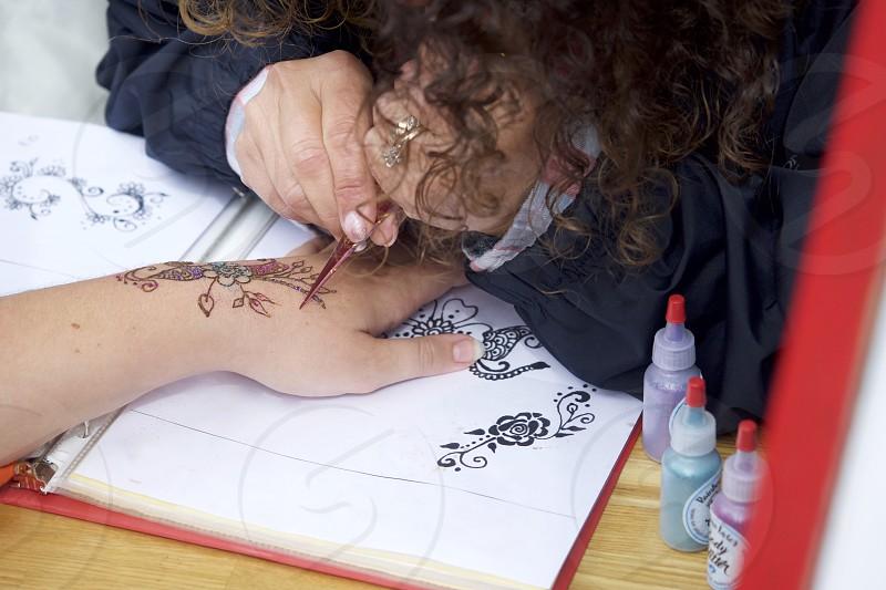 Creative maker artist painting skin photo