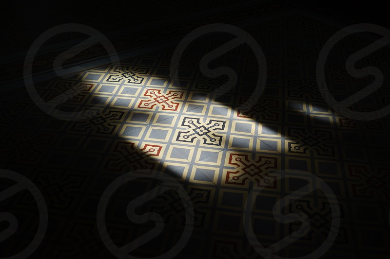 Floor pattern exposed by sunlight through stained glass in a Czech monastery photo
