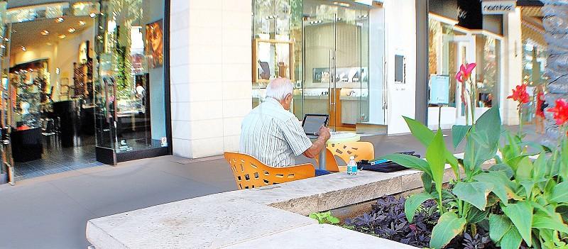 Senior laptop technology mall web surfing summertime  photo