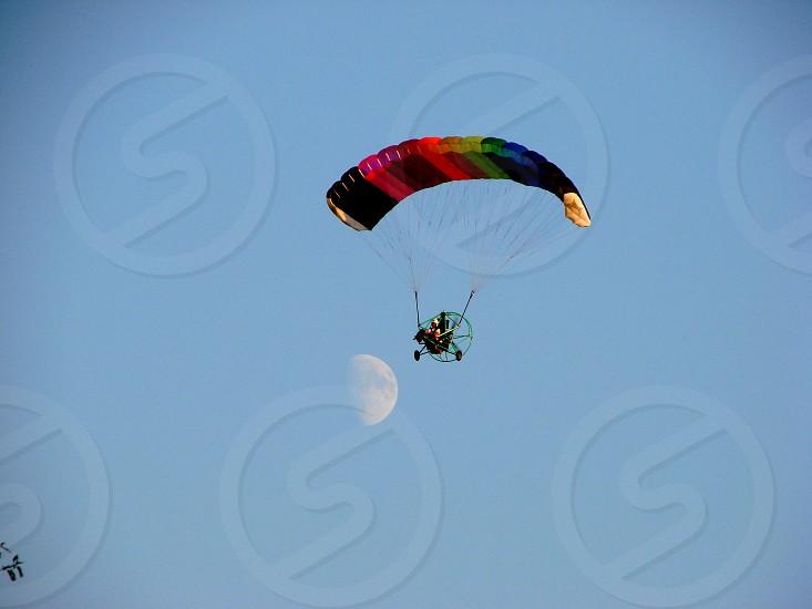 ultralight parachute rainbow moon photo