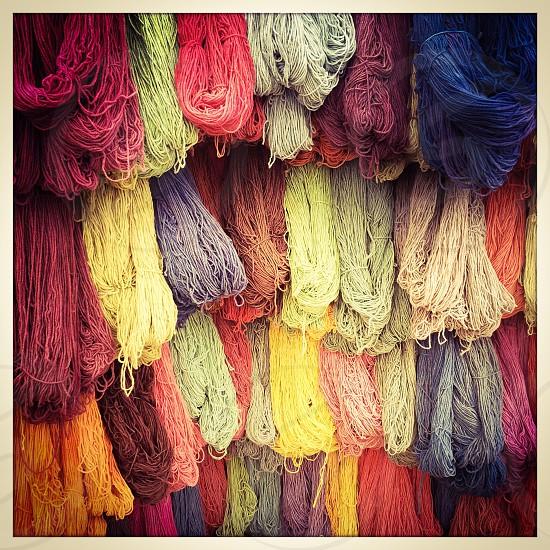 colorful yarn hanging up photo