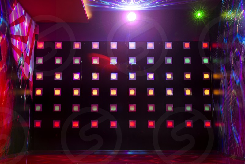 Disco with colorful lights. Dancing photo