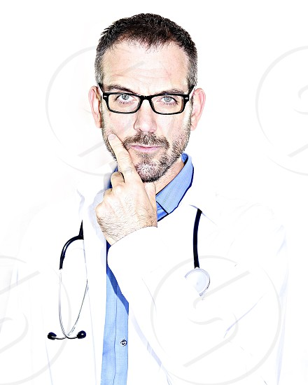 Doctor physician surgeon healthcare provider glasses beard perplexed peculiar stethoscope touching chin photo