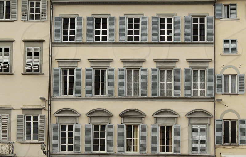 Details of a Florentine building form a background of old Windows. photo