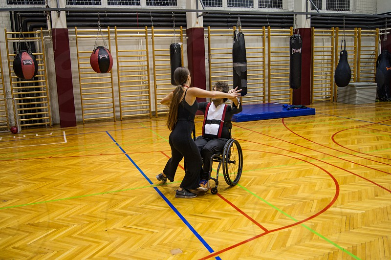 Para dancing couple practicing their choreography. Wheelchair dance sport. photo