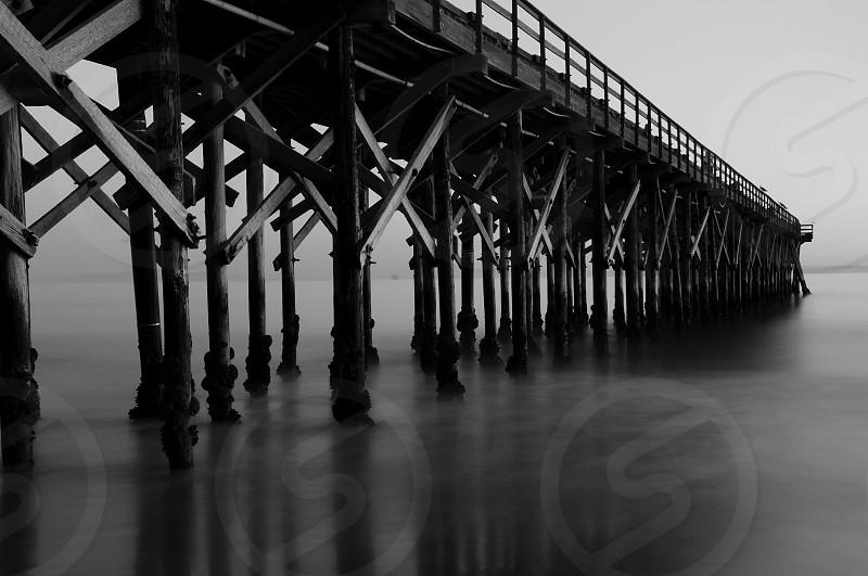 black wooden bridge photo