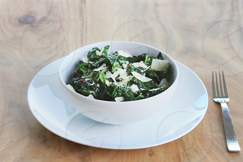 white ceramic bowl on a white ceramic dinner plate photo