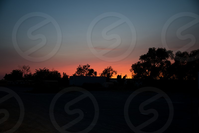 Silhouetted Landscape with Sunset Sky photo