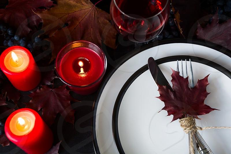 Autumn table setting on black wooden background photo