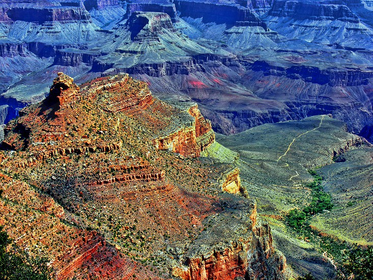 Image of the Grand Canyon; a path at the bottom of the canyon is seen below. photo