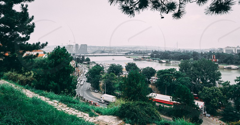 Panoramic view of the Danube and Sava rivers from the Belgrade fortress and Kalemegdan in Serbia on a cloudy summer day photo