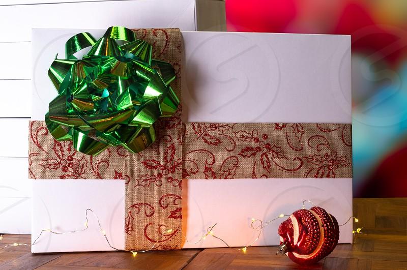 Gift box presents green bow holiday season Christmas Xmas package lights surprise  photo