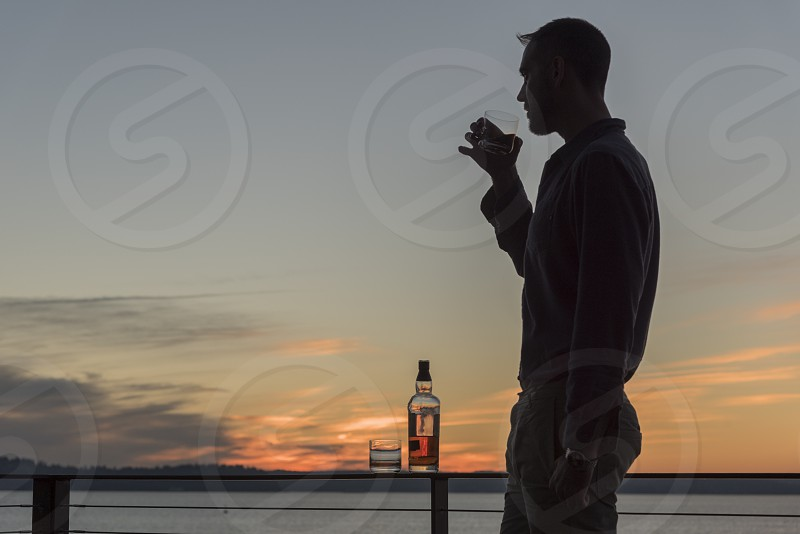 Coastal lifestyle sunsets alcohol starfish and sunbursts photo