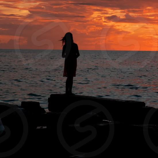 Girl Enjoying Beautiful Sunset on Beach photo