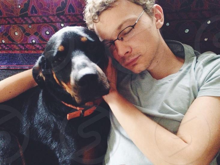 man and dog sitting photo