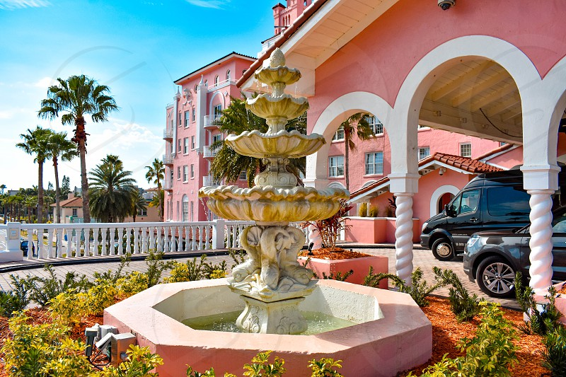 St. Pete Beach Florida. January 25 2019. Vintage Fountain close to main entrance of The Don Cesar Hotel. The Legendary Pink Palace of St. Pete Beach. photo