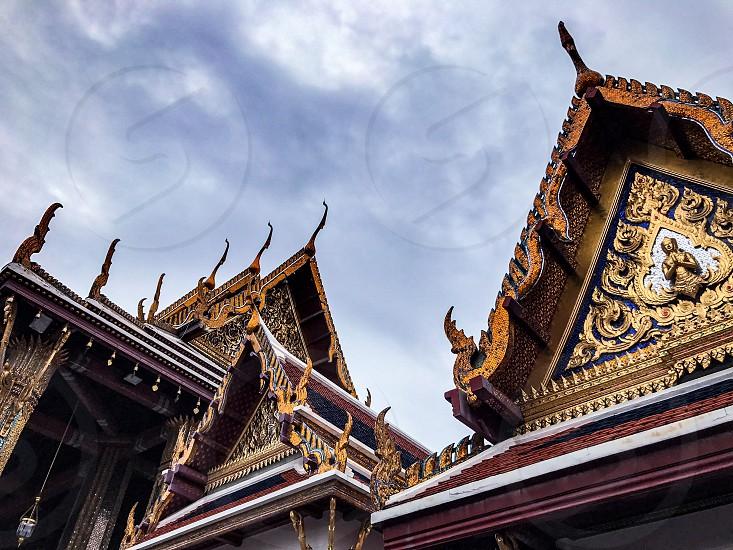Outdoor day colour horizontal landscape Grand Palace Bangkok Thailand Kingdom travel tourism tourist wanderlust gold gold leaf Buddhist Buddhism holy royal regal monarchy temple temples mosaic mirror tile tiles photo