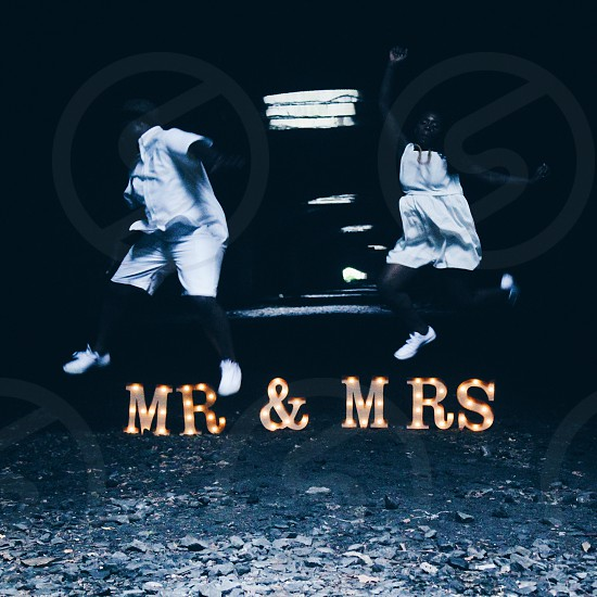 mr and mrs free standing led decor in grey scale photo