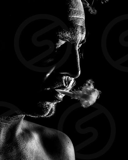 black and white low key vape exhale self portrait photo