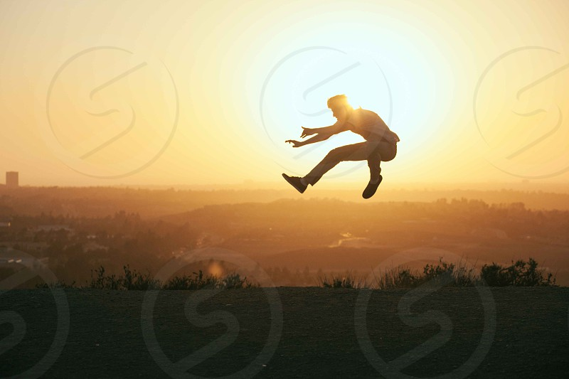 person jumping silhouette photography photo
