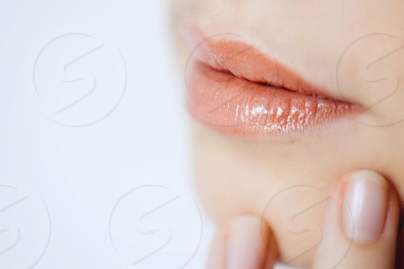 woman with orange lipstick photo