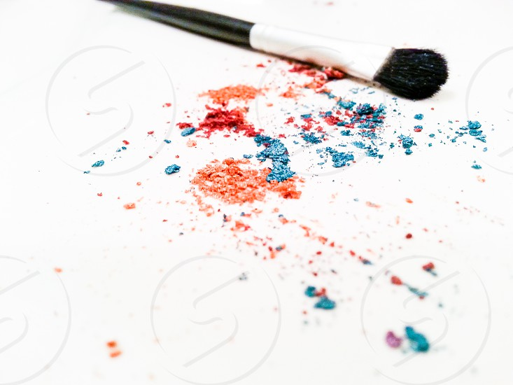make up brush beside eye shadow powder photo
