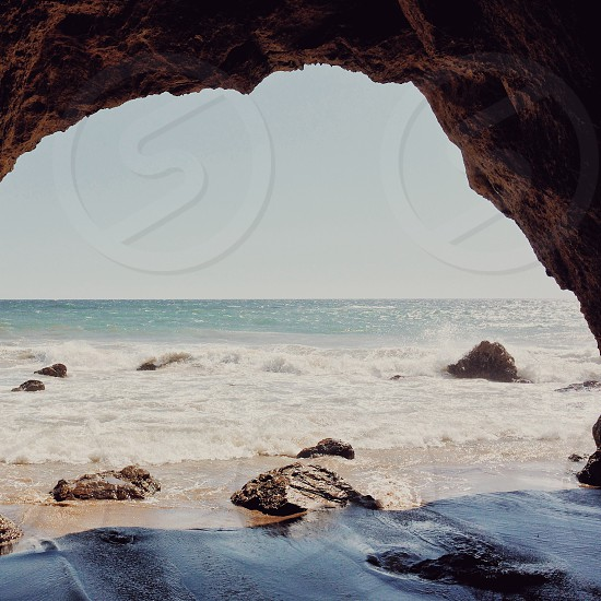 sea water view inside a cave on beach side photo