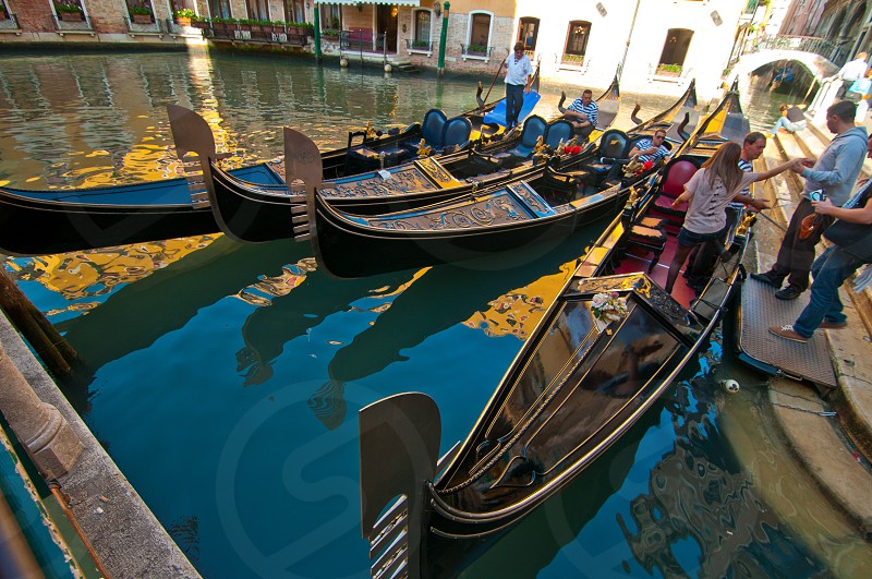 Venice Italy gondolas on canal at parking spot photo