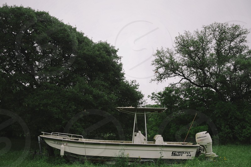 white motor boat on green grass during daytime photo