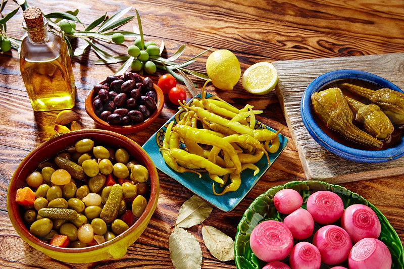 Tapas pickles mix olives chili onion eggplant from Spain photo