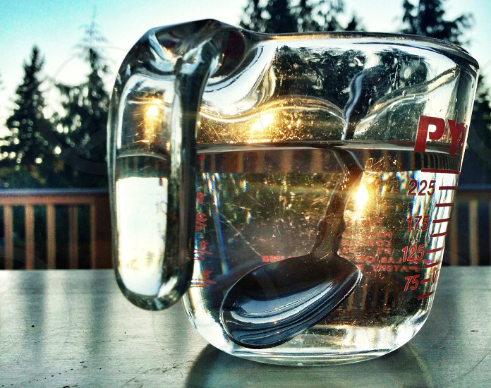 Glass measuring cup with spoon photo
