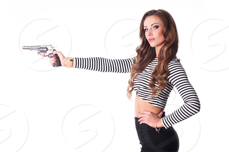 Sexy girl with gun. photo