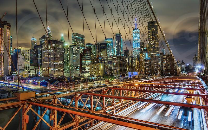 Night shot of Manhattan New York from the Brooklyn Bridge. photo