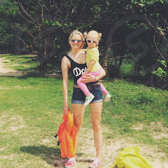 mothergirldaughterislandtravelingswim beachsmiling smile bikini cute beautifulyoungcolors photo